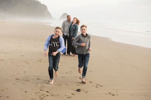 Photo of mother, father, and two children on the beach