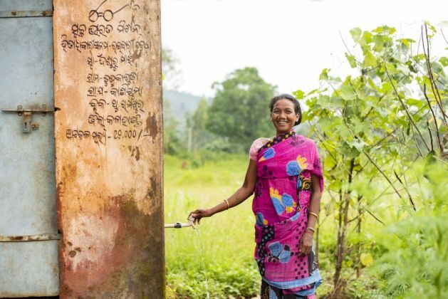 A woman collects the drinking water from the third tap in Simlipadar village in Thuamul Rampur, Kalahandi | Picture courtesy: Ajaya Behera