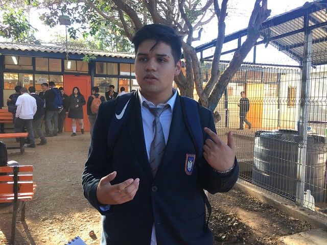 Duan Urqueta, 17, a fourth-year electronics student at the Ovalle polytechnic high school, describes the award-winning greywater filter he helped to build. Initially, units will be installed in eight rural schools in this municipality in northern Chile. Credit: Orlando Milesi/IPS