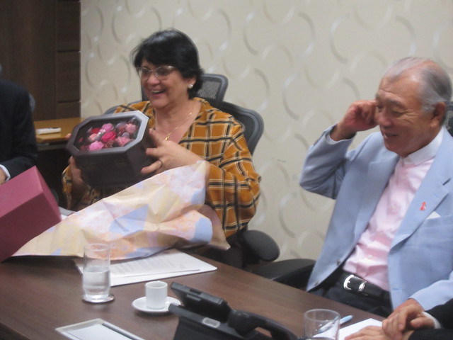 Brazilian Minister of Women, Family and Human Rights Damares Alves receives a gift from Yohei Sasakawa, president of the Nippon Foundation, at the beginning of a meeting in Brasilia, in which the minister promised to strengthen assistance to those affected by Hansen's Disease, including the payment of compensation to patients who were isolated in leprosariums or leper colonies in the past. Credit: Mario Osava/IPS
