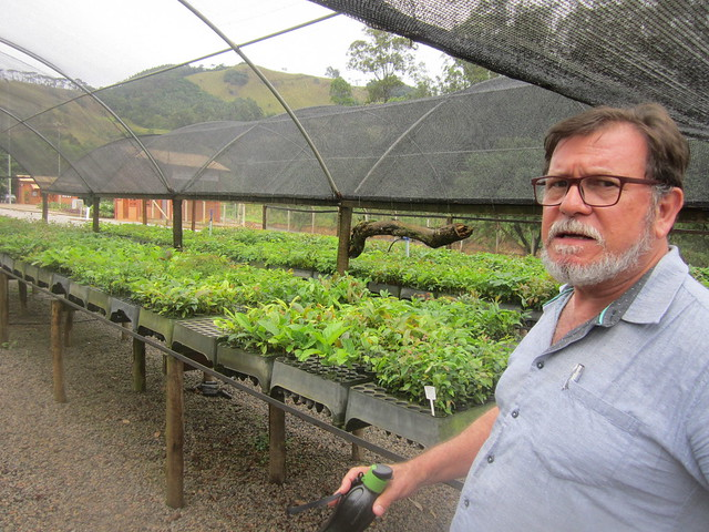 "Arlindo Cortês, head of environmental management at Extrema's Secretariat of the Environment, stands in the nursery where seedlings are grown for reforestation in this municipality in southeastern Brazil. ""Building reservoirs does not ensure water supply if the watershed is deforested, degraded, sedimented. There will be floods and water shortages because the rainwater doesn't infiltrate the soil,"" he explains. Credit: Mario Osava/IPS"