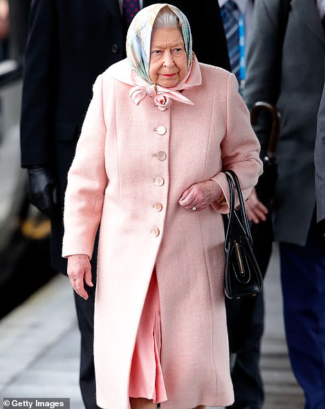 The Queen (pictured at King's Lynn railway station on December 20) is said to be furious at Harry and Meghan as they step down as senior Royals