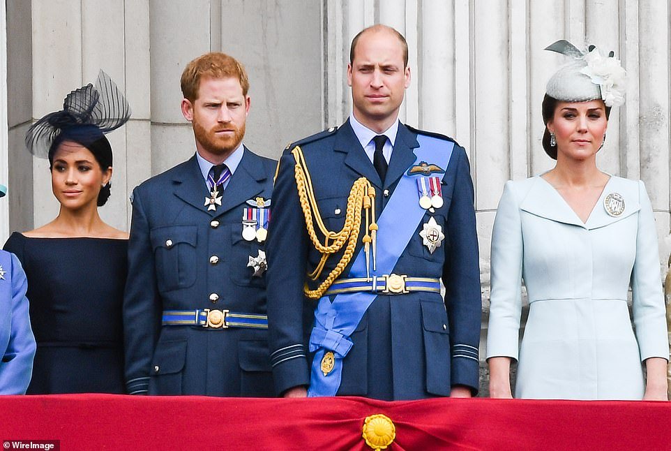 Pictured: Meghan, Duchess of Sussex, Prince Harry, Duke of Sussex, Prince William, Duke of Cambridge and Catherine, Duchess of Cambridge stand on the balcony of Buckingham Palace to view a flypast to mark the centenary of the Royal Air Force (RAF) on July 10, 2018