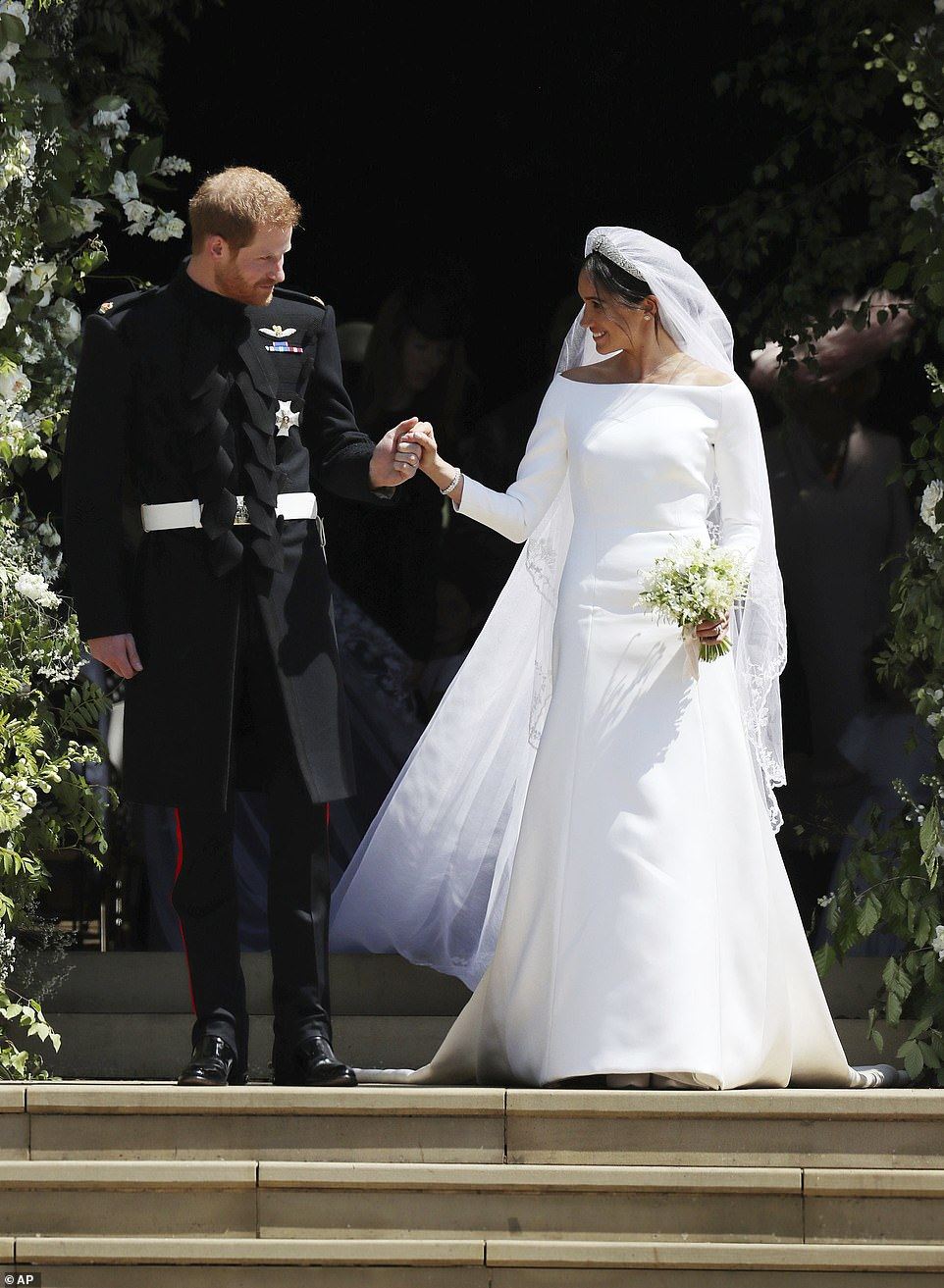 Meghan Markle and Prince Harry walked down the steps of St George's Chapel at Windsor Castle in Windsor, near London, following their wedding on May 19, 2018
