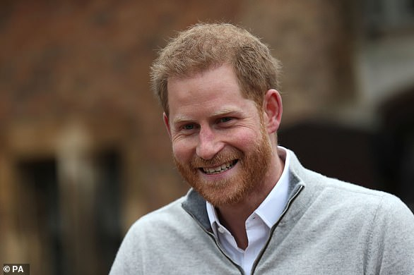 Speaking hours after his wife went into labour, an overjoyed Prince Harry (pictured) revealed that his wife had given birth to a healthy baby boy