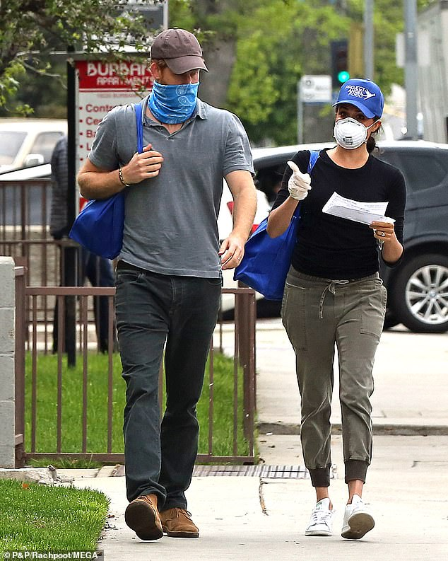 Harry and Meghan are seen in LA last week delivering meals to needy residents during the coronavirus lockdown
