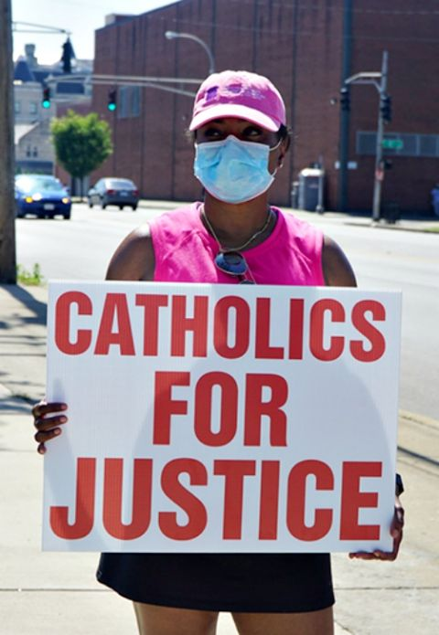 "Kenya Turner, a member of St. Martin de Porres Church in Louisville, Kentucky, joins the ""Black Catholics Unite: Stand For Justice March"" on June 6. (CNS/Courtesy of The Record)"