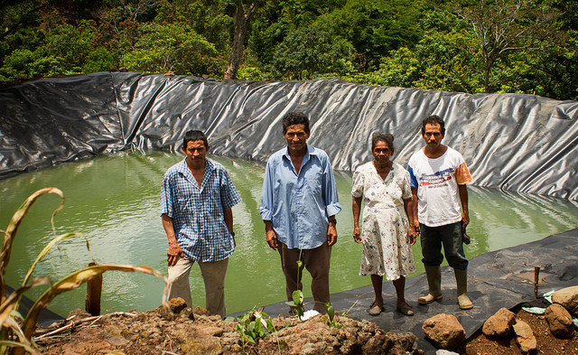 A group of peasant farmers from El Salvador stand in front of one of the two rainwater tanks built in their village, La Colmena, in the municipality of Candelaria de la Frontera. The pond is part of a climate change adaptation project in the Central American Dry Corridor. Central American farmers like these and others from Brazil's semiarid Northeast have exchanged experiences on solutions for living with lengthy droughts. CREDIT: Edgardo Ayala/IPS