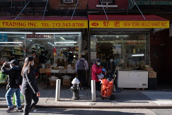 Shoppers in Chinatown. With the rise of coronavirus cases in New York City, more restrictions may come for small businesses that have already taken a financial hit.