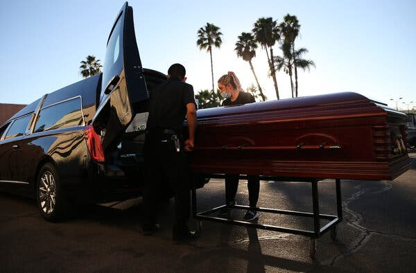 A Covid-19 victim being placed in a hearse in El Cajon, Calif., in January.