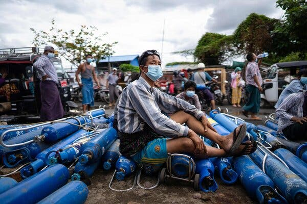 A man waiting to fill empty oxygen canisters outside a factory in Mandalay on Wednesday, in defiance of an order by Myanmar's military that denies oxygen to private citizens.