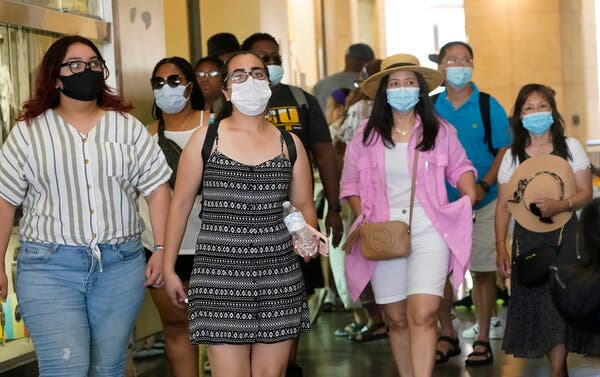 Visitors in a Hollywood shopping district wore masks earlier this month. Los Angeles County is currently averaging over 1,000 new cases per day.