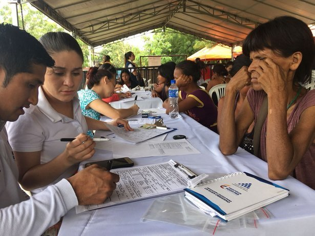 Yukpa Indians from Venezuela register upon arrival at a border post in Colombia. The legalisation and documentation of migrants arranged by the Colombian government allows migrants to access services and exercise rights in the neighbouring country. CREDIT: Johanna Reina/UNHCR