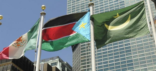 South Sudan's national flag (centre) flies at UN Headquarters following its admission as the 193rd Member State. Credit: UN/E. Schneider