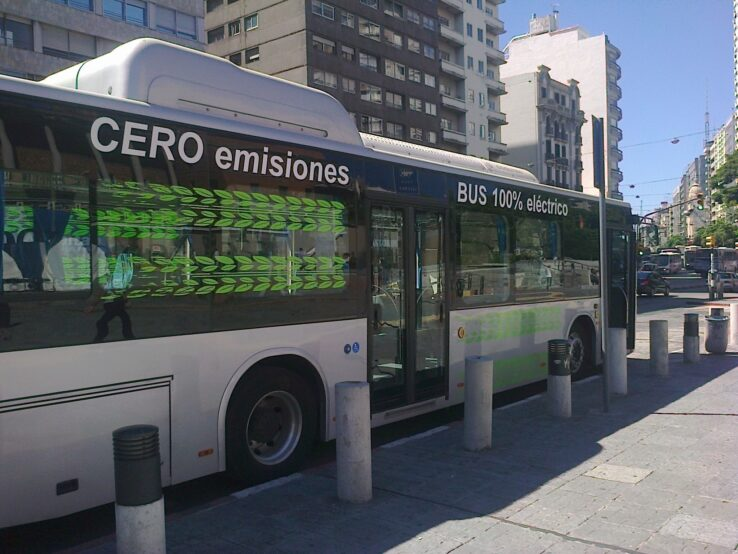A zero-emission electric bus is parked on a downtown street in Montevideo. Public transport is beginning to electrify in Latin America's cities as a way to contain CO2 emissions, but plans have been delayed and cut back due to the covid pandemic. CREDIT: Inés Acosta/IPS